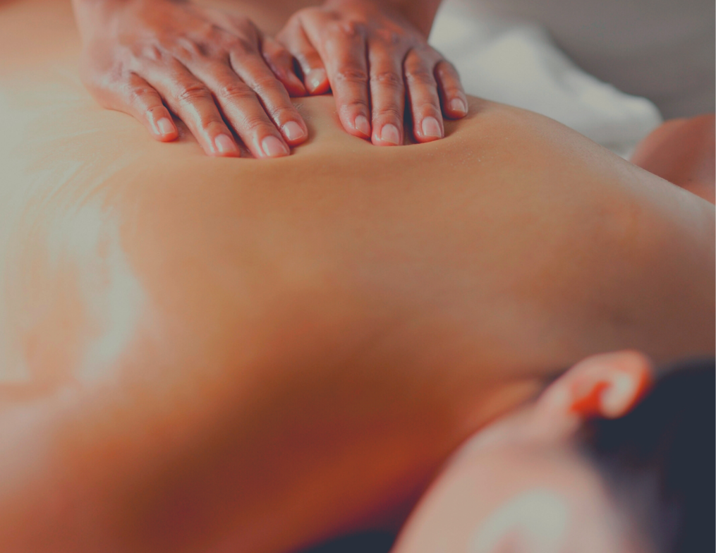 A woman's back during a massage therapy session